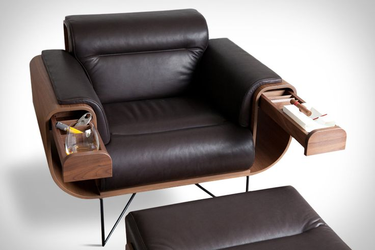 EL PURISTA SMOKERS ARMCHAIR   Enjoying a relaxing smoke is difficult when your chair's not comfortable. The El Purista Smokers Armchair ensures you get as much enjoyment as possible out of each session. Created by Rodrigo Gonzalez and Alexander Sauer, the chair's design recalls the iconic Eames lounger, but with a more square form and hidden slide-out storage in the arms that doubles as a place to set an ashtray and your drink of choice.