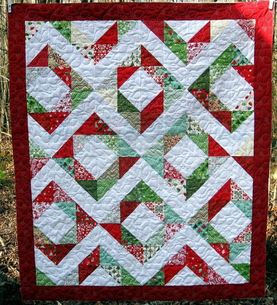 Whether its Rudolph, Frosty or the Grinch, this quilt was meant to snuggle under! Featuring Modas Joy by Kate Spain and fabric in shades of red, aqua and green, this 48 x 55 quilt is all about Christmas!    Perfect for two adults, or one adult and two children and a bowl of popcorn, this quilt is made to last many years. The Moda and Kona 100% cotton fabrics are densely quilted using a string of Christmas Lights design. The quilting closely matches the designs on the fabric and makes for a…