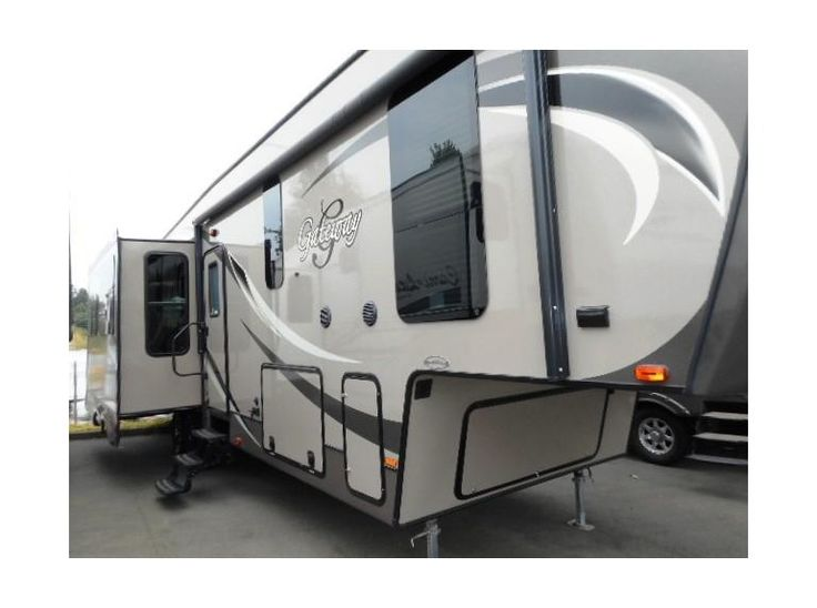 Get most affordable deals on Cheap Used 2014 #Heartland Gateway3200RS #Fifth_wheel by Camping World RV Sales of Portland for $59788 in Wood Village, OR, USA. This Heartland Gateway3200RS Fifth wheel equipped with 3 Slide Outs, Battery, Center Kitchen, Deluxe Cabinets, Double door refrigerator, Dual Ducted AC, Free Standing Dinette, Front Queen Bed, Full Rear Wardrobe, Grab Handle and many more. Find out more information at: http://goo.gl/P8yiEE