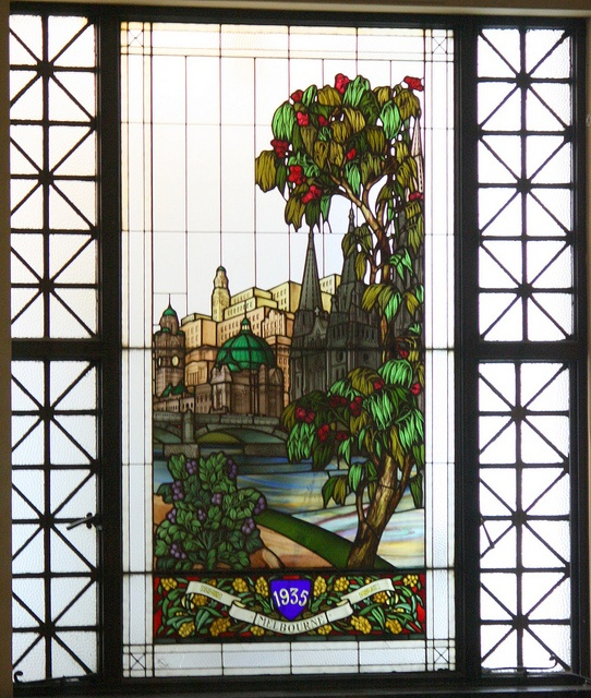 Melbourne Town Hall, leadlight window featuring the Yarra river, Flinders street Station and St Patricks cathedral