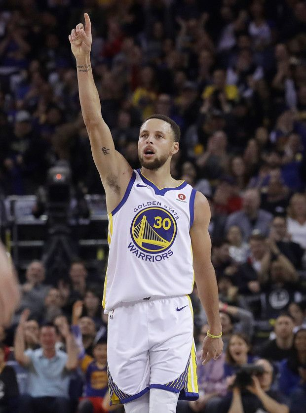 Golden State Warriors guard Stephen Curry (30) reacts after scoring against the Brooklyn Nets during the first half of an NBA basketball game in Oakland, Calif., Tuesday, March 6, 2018. (AP Photo/Jeff Chiu)