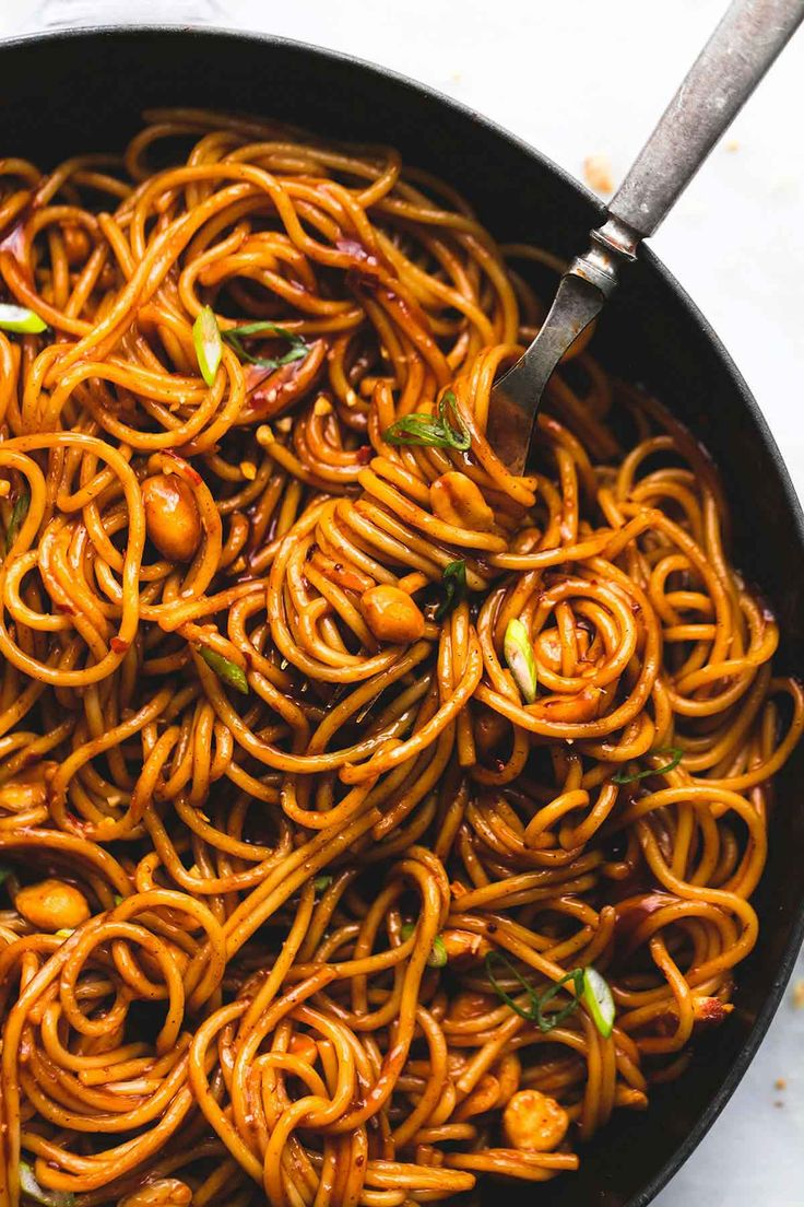 Spicy kung pao noodles are a cinch to whip up in just 20 minutes with the best sweet and spicy kung pao sauce. Easily add chicken, shrimp, or beef to amp this side up up to a full meal. | lecremedelacrumb.com