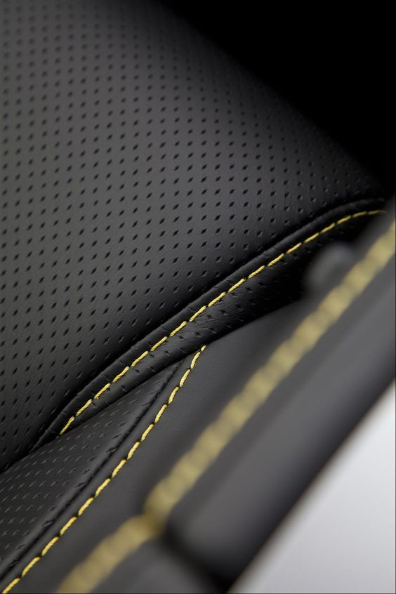 Luxury car interior inspired leather seats and stitching