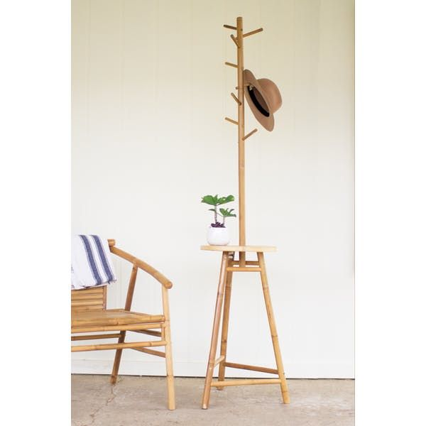 Kalalou Bamboo Coat Rack Table. The neutral golden hue of notched bamboo can be a useful and decorative touch in a tropical entrance way.