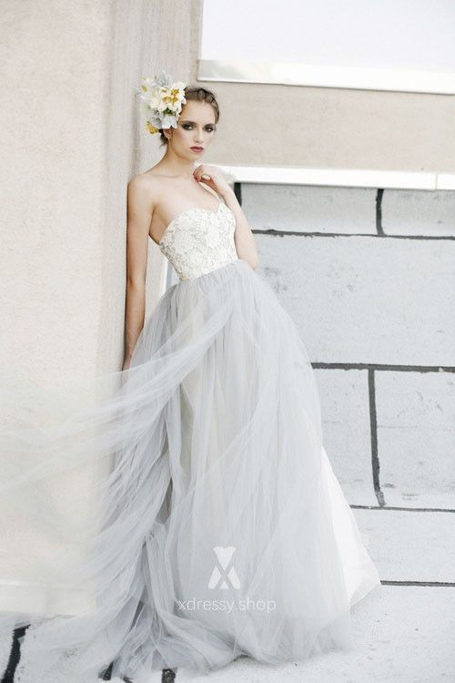 9aefcac96f5 Alluring wedding dress made of smoky blue tulle with strapless sweetheart  neckline decorated with subtle white
