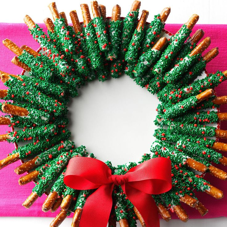Chocolate-Dipped Pretzel Wreath Recipe -Give chocolate and pretzels the holiday treatment they deserve when you shape them as a wreath. Make one for the house and more to give away. —Shannon Roum, Milwaukee, Wisconsin