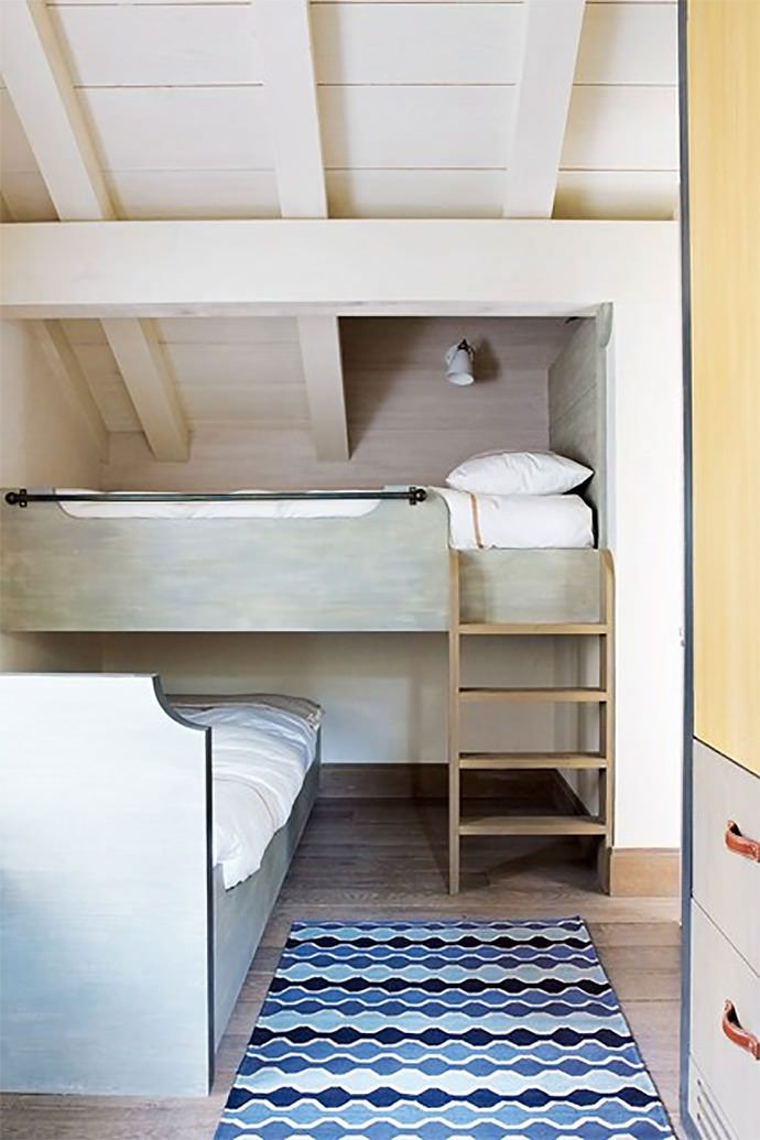 Uniquely Stacked Bunk Beds- great solution for odd shaped room.  Little kids would the little space under the ladder.