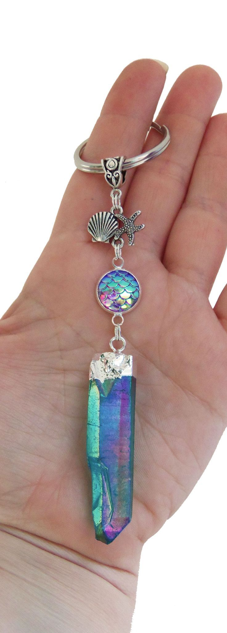 pretty aqua blue aura crystal with mermaid scale, starfish and seashell keychain.