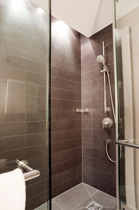 tiled modern shower cubicle with glass door free stock