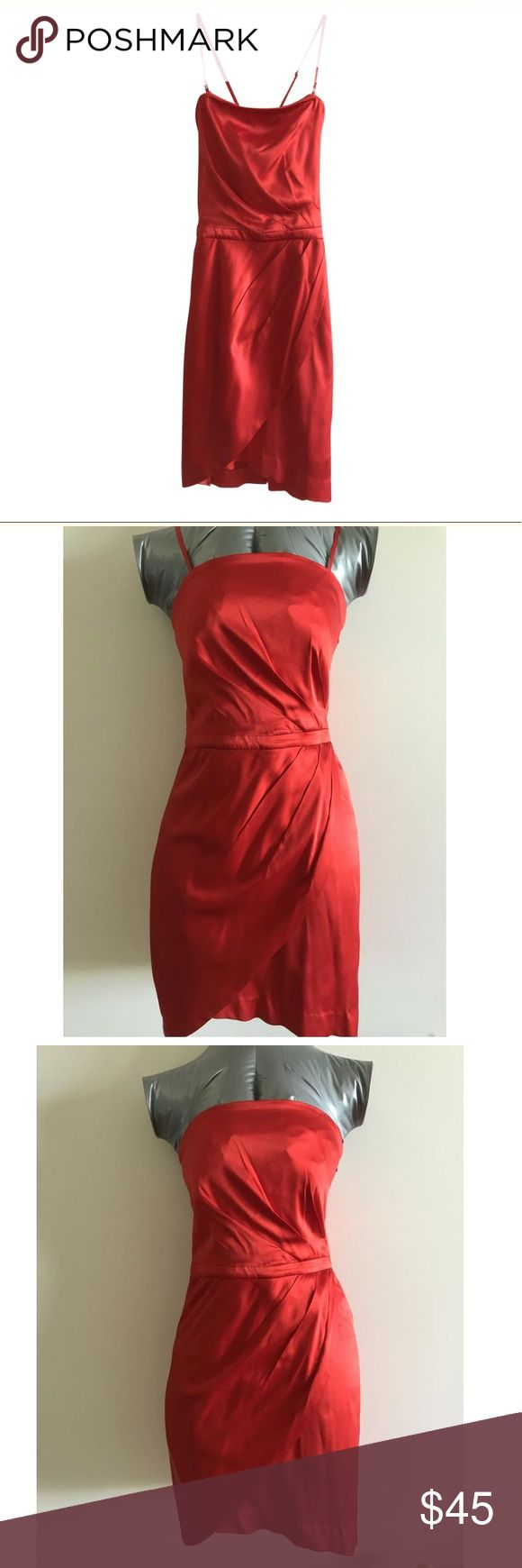 Armani Exchange Silk Dress - Burnt Orange Size 0 Armani Exchange Silk Dress - Burnt Orange  Size 0  Silk - 93%  Spandex - 7%    Gorgeous dress. Bottom folds make the dress look like an upside down tulip.   Beautiful burnt orange silk dress.   Skirt has a slip underneath. Straps can be taken off.  Upper part can be worn strapless, regular straps, or crossed straps.    Two slight translucent stains on the front of the upper bodice.   Refer to photo (I am pointing out where the stain is). A/X…