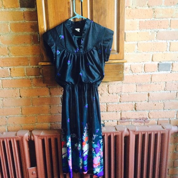 Vintage Sheer Dress Vintage black dress with floral design on bottom of dress. Is very see through, would be worn with a slip under. Very classic and in great condition. Dresses