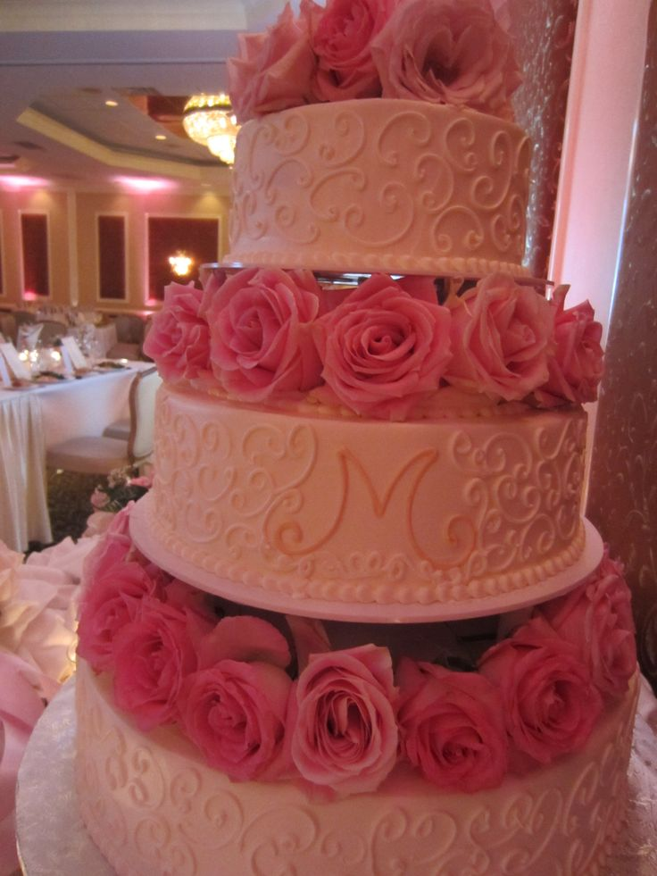 Pretty In Pink! Lovely pale pink roses accent each tier...