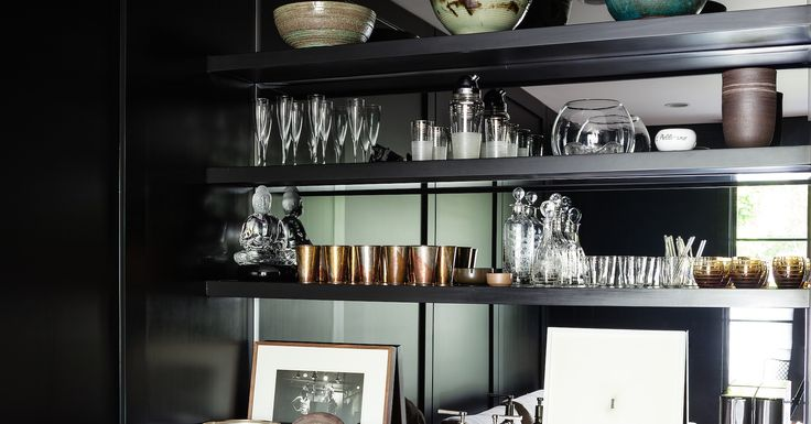 Pottery by Victoria Morris, William Yeoward decanters, Hermès cocktail glasses, and a photo of The Rolling Stones are just some of the items lining the bar. Kayne uses the rose gold, pewter, and brass cups (a birthday present from her mom) for