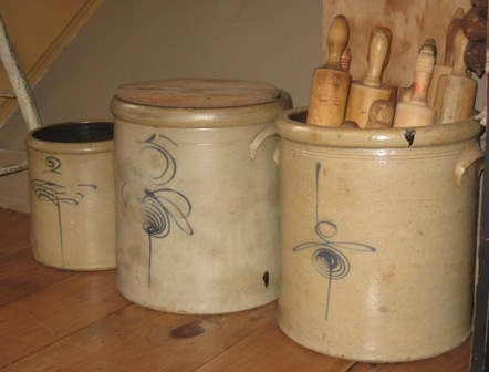 Old crocks can be used to display your primitive collections.