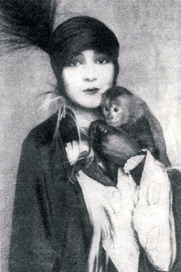 "Weimar Berlin personality Ruth Roellig with pet monkey. Source: ""Hot Girls of Weimar Berlin,"" Feral House, 2002."