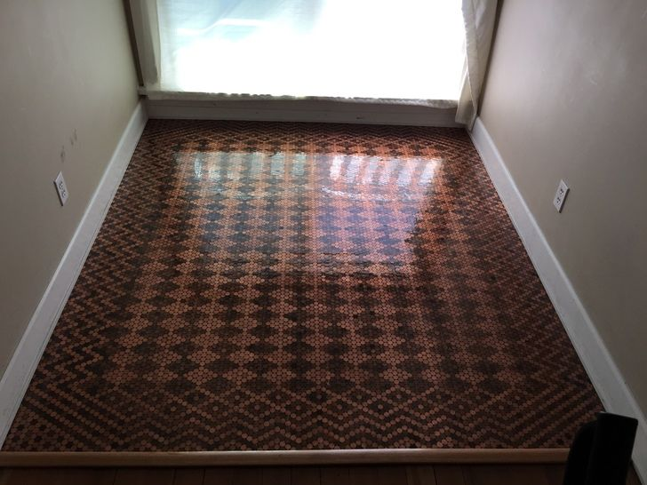 Penny floor... $150 worth of pennies + $175 worth of epoxy