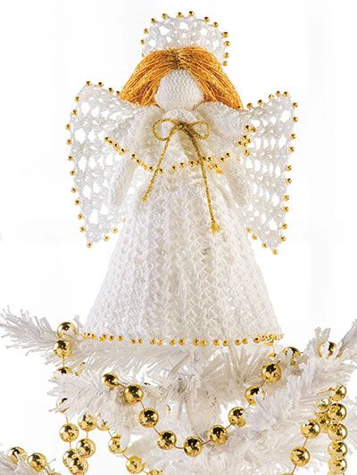"""Top your tree with this heavenly angel that will watch over you all season long. This e-pattern was originally published in the December 2008 issue of Crochet World magazine. Size: 9""""H. Made with size 10 crochet cotton thread and size 6/1.80 steel hook. Skill Level: Intermediate"""