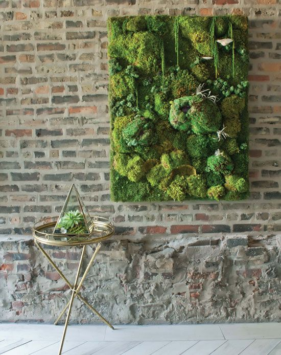 LOVE the look of moss walls and the little stand ahead of it. Could DIY this if we can make it fit.