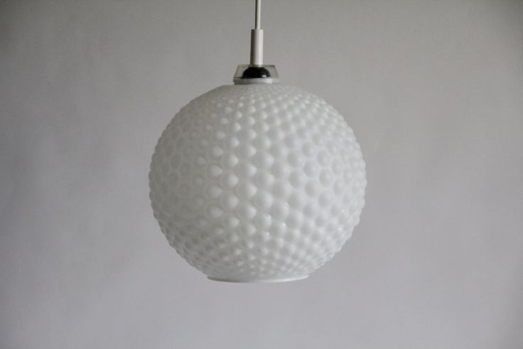 Beautiful sphere lamp made of frosted glass with a geometric bubble pattern. Lampshade in white, frosted cased glass. Suspension made of plastic. Plastic cable management bracket original canopy. Socket E 27th Dimensions: Height: 35 cm Diameter: 32 cm Weight: 1189 gr Condition: Good with few age-appropriate wear. One small chip (about 1 mm) on the bottom aperture. No cracks or spalling.