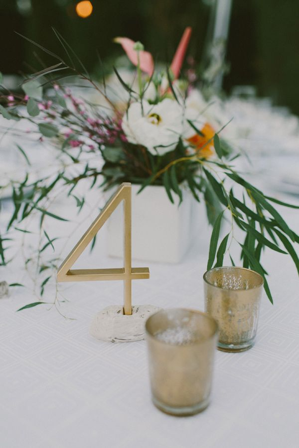 gold table numbers - photo by Laura Goldenberger…