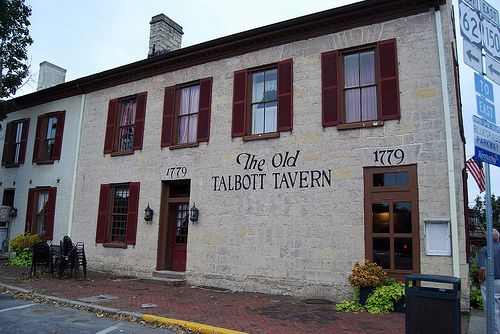 Since the late 1700s, the Old Talbott Tavern on Court Square in Bardstown, Kentucky has provided shelter, food & drink to travelers. Figures straight from the history books sought food & shelter here during their travels; as a young boy Abraham Lincoln & his family stayed here, Gen. George Rogers Clark, Daniel Boone, & exiled French King Louis Phillipe and his entourage stayed here, even painting murals on the upstairs walls. There are five overnight rooms available including modern…