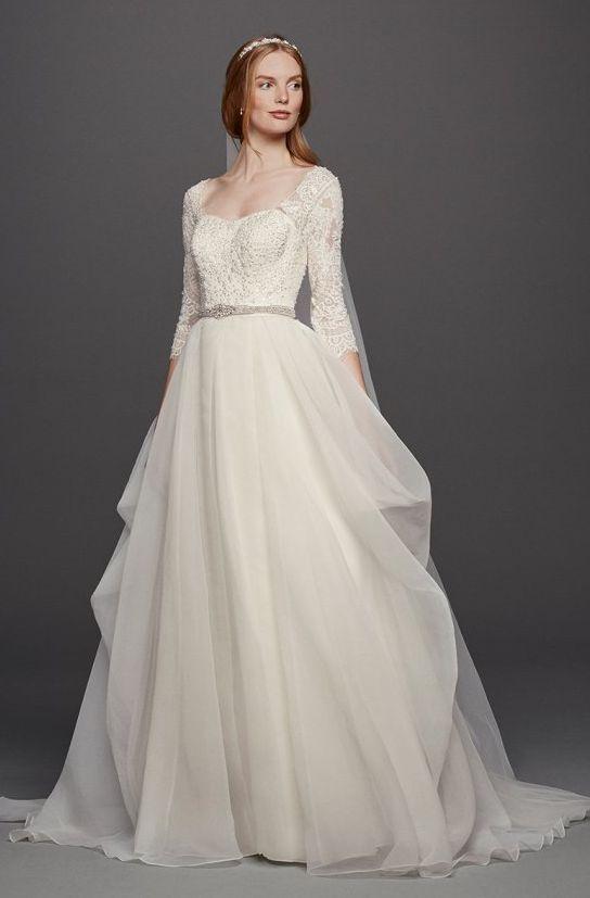 Stunning embellished bodice wedding dress with quarter length sleeves; Featured Dress: Oleg Cassini