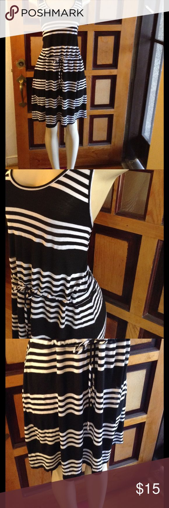 "Apt. 9 summer dress Cute black and white striped dress.  Drawstring waist, razor back.  Very comfy stretchy fabric.  Measures 20"" bust, 39"" length.  Perfect for weekend wear.  In good condition.  Size M.  Please use offer to negotiate.  No holds and no trades, Bundle and save. Apt. 9 Dresses"