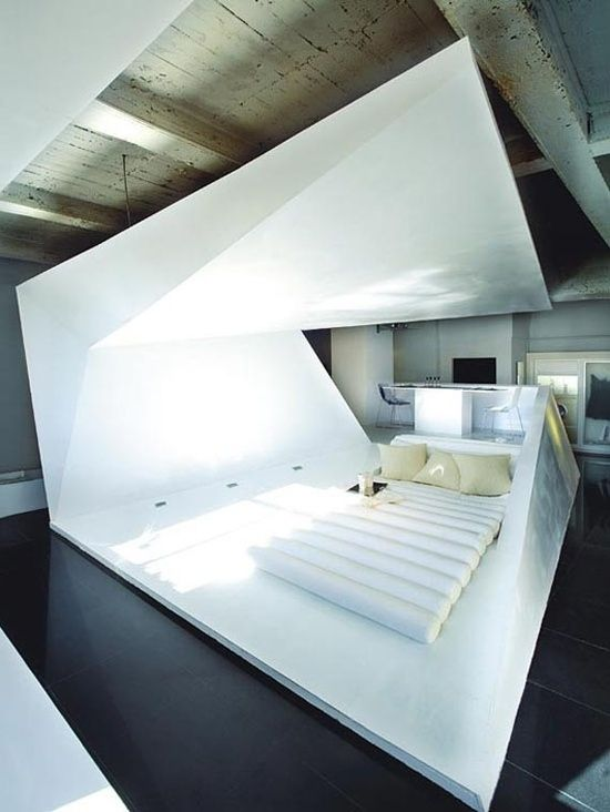 In a super futuristic bedroom.