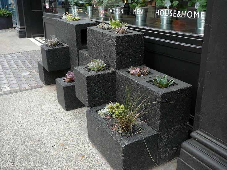 Cinder block garden painted black.