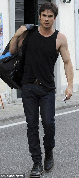 Muscle man: Ian showed off his muscles in a black vest top for the outing