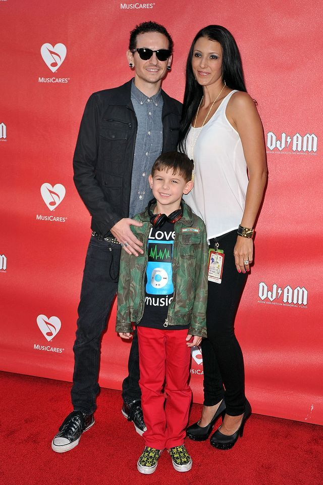 <p>Chester Bennington, wife Talinda Bennington and son Tyler Lee Bennington arrive at the 9th Annual MusiCares MAP Fund Benefit Concert at Club Nokia on May 30, 2013 in Los Angeles, California. (Photo: Jerod Harris/WireImage) </p>