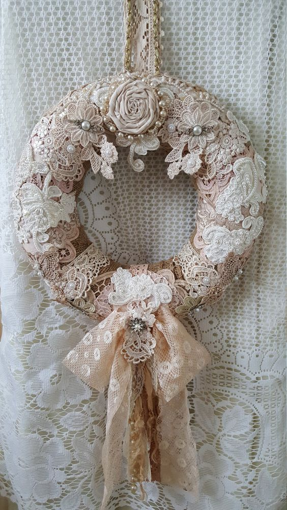 This is a flat-backed Styrofoam wreath.Here I have covered the wreath in burlap.I have then added lots of lace,doilies,and wedding appliques: