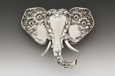 "Elephant Brooch Pin | SILVER SPOON JEWELRY The ears of this majestic elephant are crafted from the handles of two spoons, while the face and trunk are formed by a third spoon handle. Dimensions: 2"" x 1 3/4"" silver plate Made in the USA"