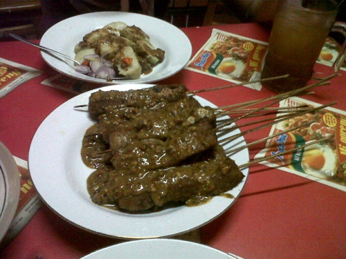 Sate Kere Yu Rebi is grilled beef intestine or 'tempe gembus' (soft soy bean cake) with spicy peanut sauce.