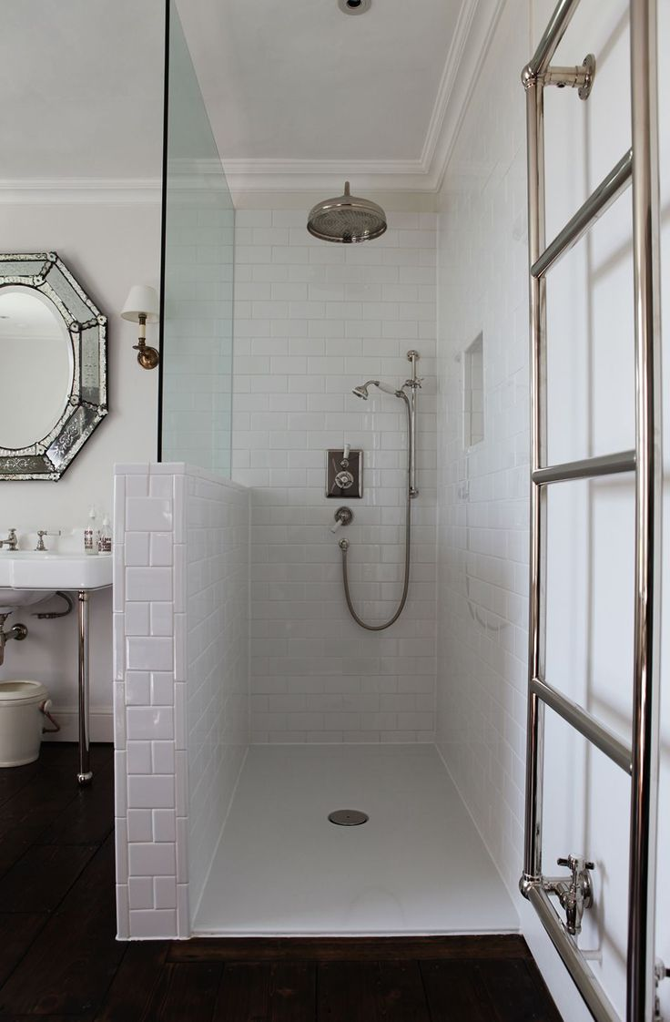 Open walk in shower, subway tiles, glass partition, towel rack