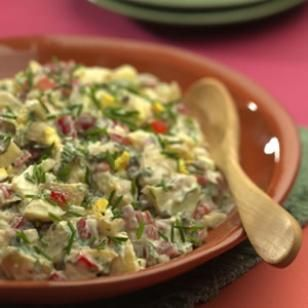 Creamy Potato Salad  Tossing potatoes with a little good vinegar while they are still warm infuses them with flavor. Capers, gherkins and a touch of anchovy give this old-fashioned salad a piquant finish, while red bell pepper and celery give it an appealing crunch.