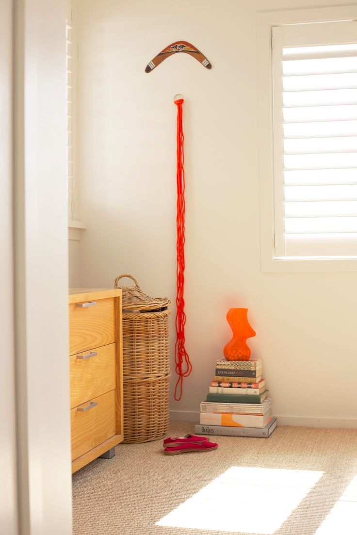 #funky bedroom #boomerang #stack of books #orange vase #espedrills. Staging by Places and Graces.