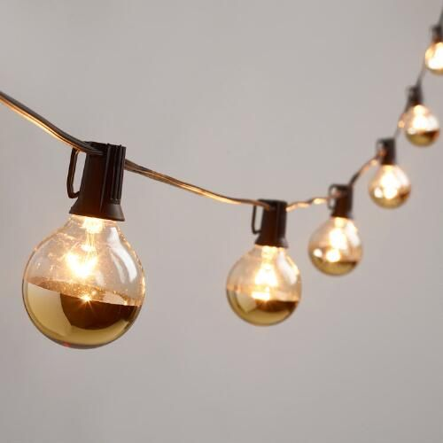 One of my favorite discoveries at WorldMarket.com: Gold Dipped Glass Orb 20 Bulb String Lights