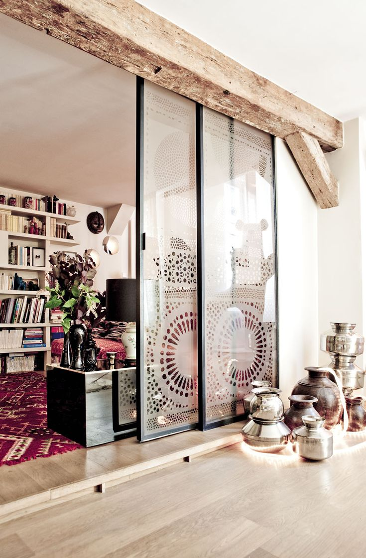"""Indian getaway: In the former leather firm which became the Parisian apartment of Stephanie, designer of Ouma Productions, the joyful and colorful spirit of Bollywood is blowing. Photo: Louise Desrosiers"" // love the sliding doors with... lace inserted?"