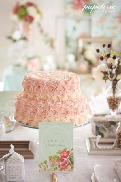 I really like the idea of a elegant cake then some antique plate stands for finger foods