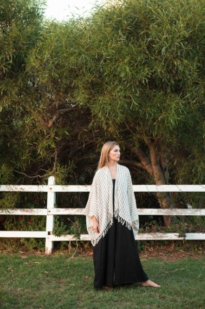 Less is more, so they say, and the short version of this popular poncho certainly lends a sweet sophistication and elegance to any outfit.  Made with 100% low impact dyed cotton, handmade by artisans in Guatemala who hand make each woven piece with care and traditional skills.    Every piece purchased supports and empowers the artisans to improve their living standards for their families and communities.