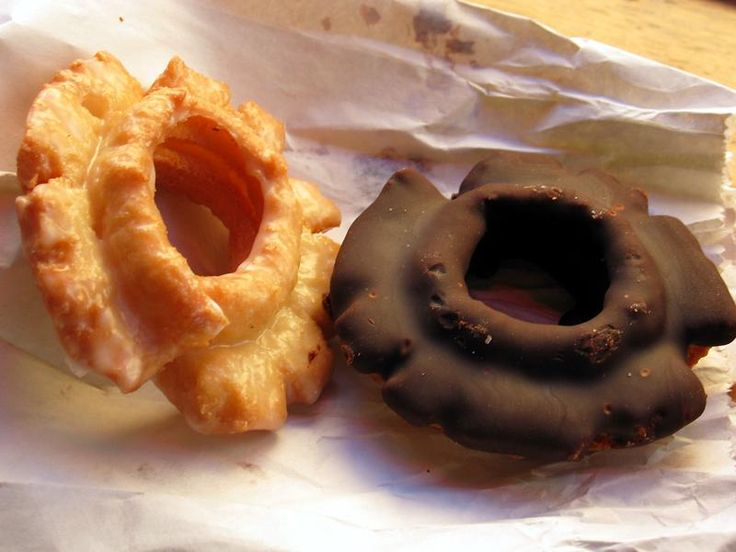 There is an immensely satisfying crunch to the crust of these old fashioned doughnuts, glazed to the left, chocolate-frosted to the right.