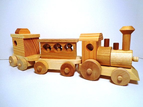 Fun With Four is doing a $50 gift card giveaway to Ozark Rustic Woord! :) I'd get this Wooden Toy Train Set  Heirloom Quality