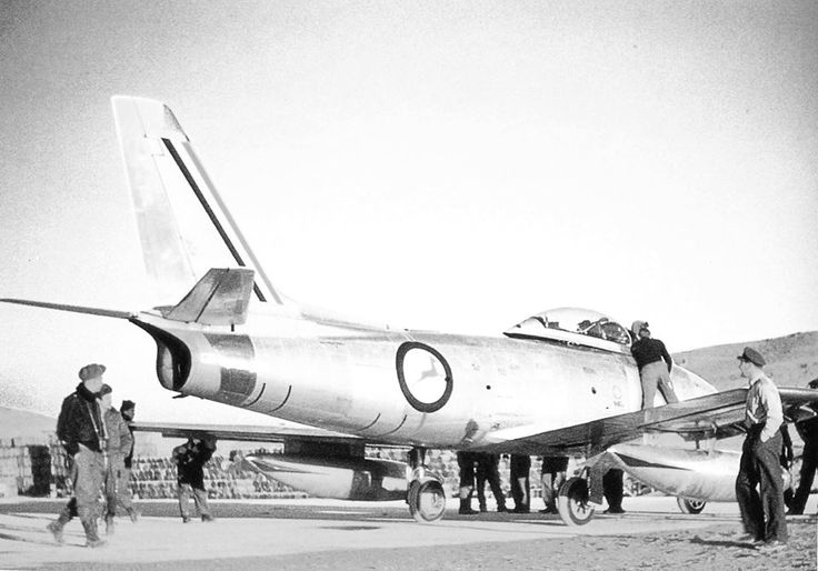 An unusual photo of a 18th FBW Sabre painted in SAAF markings.