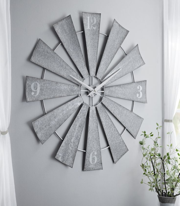 Add some flair to your country chic home with the 'Anniblaire Galvanized Windmill Clock' from Kirkland's! Shop at $99.98 through 12/31 and give your wall decor an update for the new year.