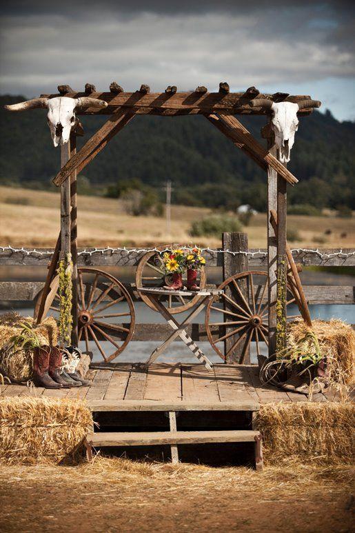 Rustic outdoor wedding altar with bull skulls