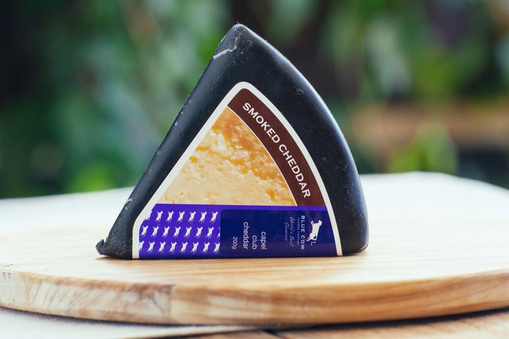 Blue Cow Smoked Capel Cheddar - Made from milk sourced from the surrounding districts of  Capel, WA, this is a traditional club style cheese.  Matured for  4 months, the paste is smooth amd dense, with a creamy,  smoky flavour, with just a hint of acid on the back palate.