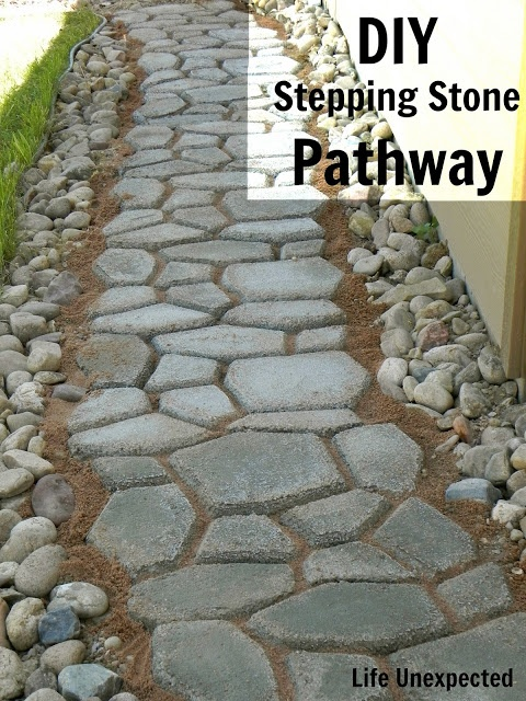 DIY Stepping Stone Pathway. We found a pathway under our grass. Now we want to expand it!!! This is a great way to go about it!!!