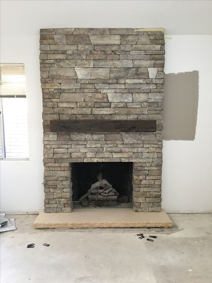17 Best Ideas About Stacked Rock Fireplace On Pinterest