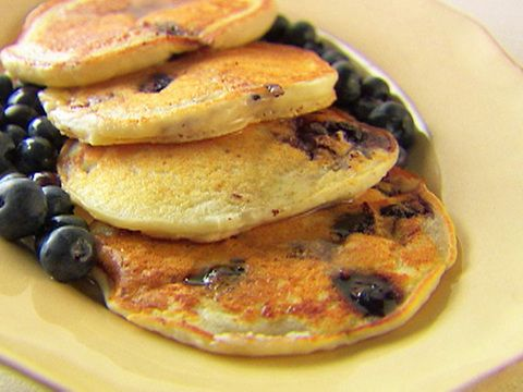 Ricotta blue berry pancakes with honey syrup. Add lemon zest to batter!